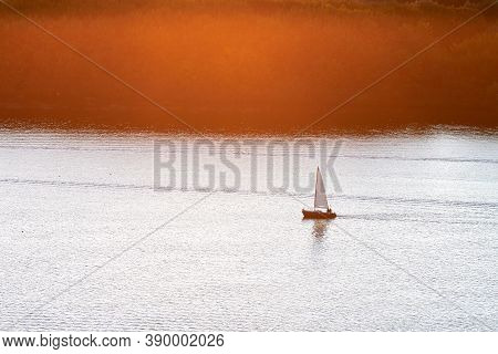 Yacht With White Sail Sails In Bay At Sunlight. Yacht Gliding At Sea. Beautiful Waterscape.