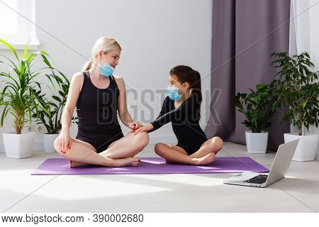 Covid-19 Shutdown. Mother And Daughter In Quarantine Doing Yoga Indoors. Mother And Daughter Doing M