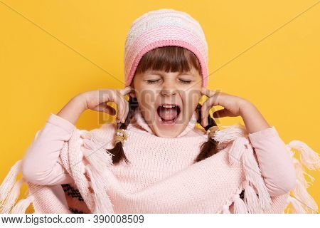 Dark Haired Baby Covered Her Ears With Finger, Child Does Not Want To Hear Anything, Young Female Ki