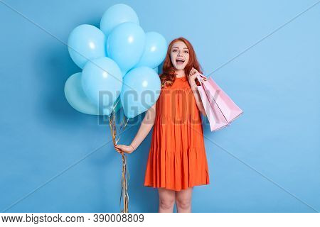Red Haired Young Woman Girl In Dress Isolated On Blue Background. Birthday, Holiday, Party, Celebrat