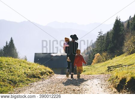 Family In Nature Outdoor. Woman With Kids On Hiking Trail In Mountains.