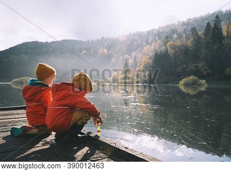Little Children Spend Time Outside In Nature.
