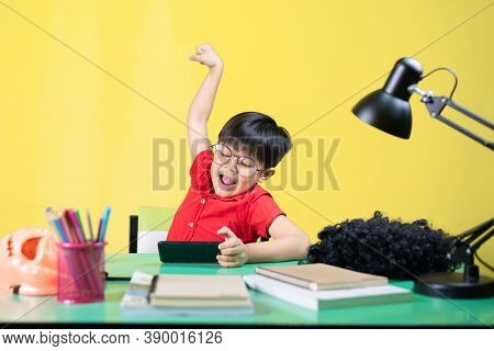 Boy Playing Smartphone, Happy Gestures On Table.