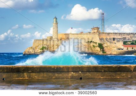 Hurricane in Havana with a view of the castle of El Morro and big waves crashing against the wall