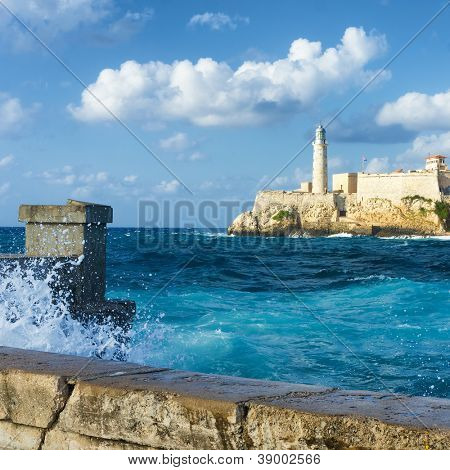 The castle of El Morro in Havana with a stormy weather and big waves crashing against the wall