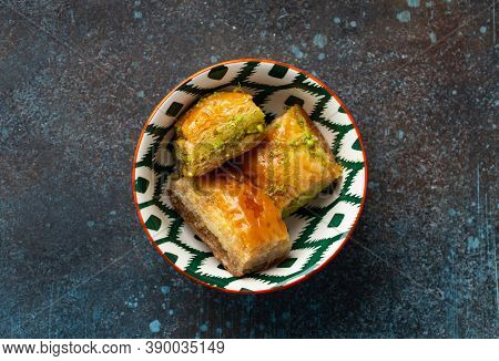 Baklava - Traditional Turkish Dessert Pastry Made Of Filo Layers With Chopped Nuts And Syrup. Popula