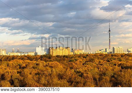 Urban Park And Residential District On Horizon Lit By Autumn Sunset Sun In Moscow City