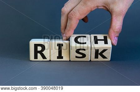 Take A Risk And Getting Rich Concept. Hand Flips A Cube And Changes The Word 'risk' To 'rich' Or Vic