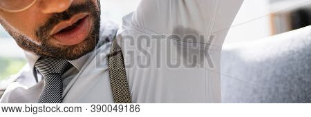 Armpit Sweat Stain From Deodorant Or Hyperhidrosis. Men Sweating