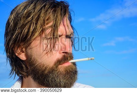 Bearded Man Smoking Outdoor. Cigarette Smoke. Tobacco. Smoking Hipster. Bearded Man With Cigarette.