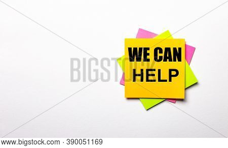 On A Light Background - Bright Multicolored Stickers With The Text We Can Help. Copy Space