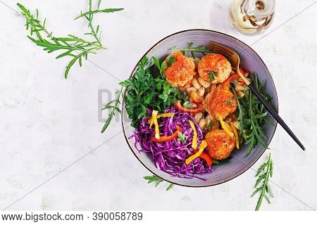 Italian Pasta. Cavatappi With Meatballs And Salad On Dark Background. Dinner. Top View, Overhead. Sl
