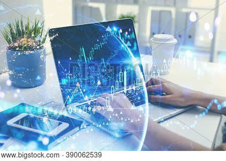 Hands Of Businesswoman Using Computer In Blurry Office With Double Exposure Of Earth Hologram. Toned