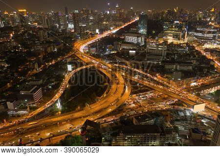 Aerial View Of Cars Driving On Highway Junctions. Bridge Street Roads In Connection Network Of Archi