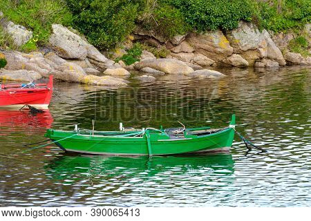 Wooden Fishing Boats Moored Near The Shore