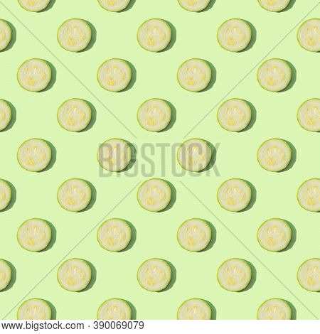 Zucchini Isolated On A Green Background. Seamless Pattern Of Zucchini On A Mint Background. Flat Lay