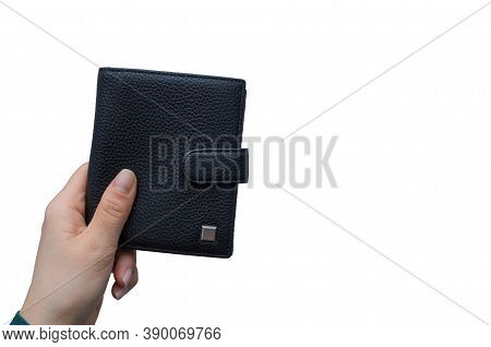 Young Woman Holds In Her Hand Large Expensive Wallet Made Of Black Genuine Leather Isolated On White