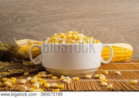 Corn Lies On Canvas. A New Crop. Fresh Corn Closeup. Corn Cob On A Plate. Sweet Corn On Background F
