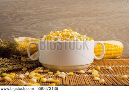 Corn Lies On Canvas. A New Crop. Fresh Corn Closeup. Corn Cob On A Plate. Sweet Corn On Background F