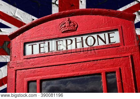 A Top Part Of Classic Red London Phonebox With Union Flag In The Background