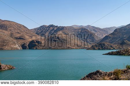 Vicuna, Chile - December 7, 2008: Landscape Of Brown Mountains And Azure Water Lake Embalse Puclaro