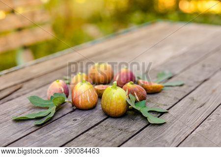 Fresh Ripe Figs On Dark Table. Healthy Mediterranean Fig Fruit. Fresh Figs On Black Background. Beau