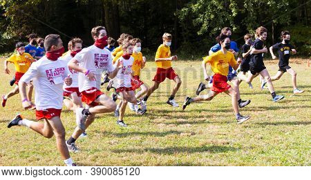 Syosset, New York, Usa - 10 October 2020: The Start Of A Boys Freshmen Cross Country Race During The