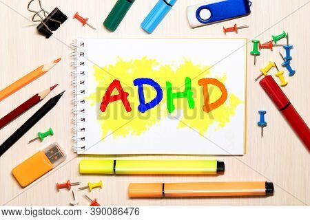 Adhd Written On Sheet Of Paper By Crayons. Adhd Is Attention Deficit Hyperactivity Disorder