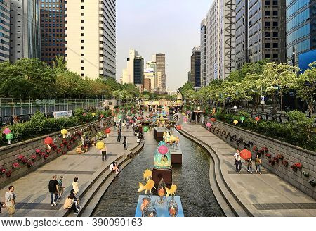 Seoul, South Korea - May 2, 2017: Sunset view of Cheonggyecheon Stream with light decorations and lanterns during the lotus lantern festival. Cheonggyecheon city landmark and downtown recreation place