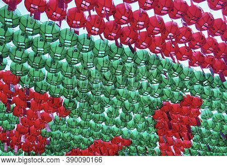 Seoul, South Korea - April 30, 2017: Green and red asian paper lanterns form a colorful background. Daegaksa Buddhist temple. Lotus Lantern Festival.