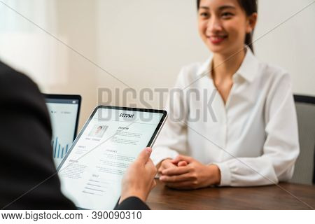 Company Human Resource (hr) Is Holding A Resume Application On Tablet In Hand. Young Asian Woman Tal