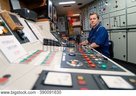 Marine Engineer Officer Controlling Vessel Engines And Propulsion In Engine Control Room