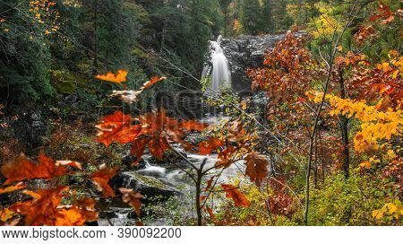 Scenic Dead river water falls in Michigan upper peninsula near Marquette city during autumn time