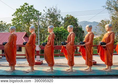 The Statue Of Buddhist Monk Standing In A Rows, Decoration In Buddhist Monastery In Tachileik A Bord
