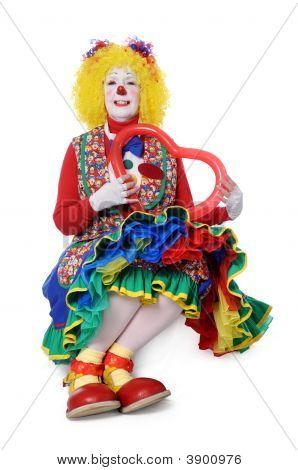 Clown Holding Heart Balloon