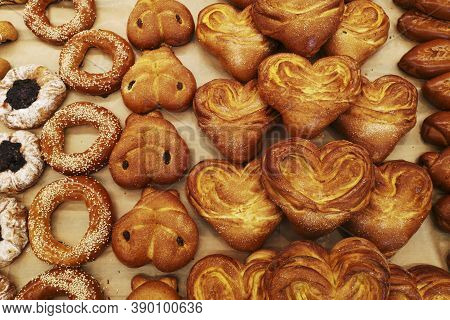 Modern Bakery With Different Kinds Of Bread And Buns. Different Kinds Of Fresh Bread As Background,