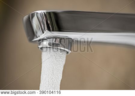 Water Tap Flowing In The Bathroom. Open Chrome Faucet Washbasin
