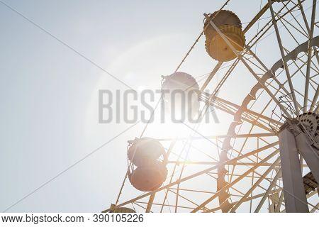 Ferris Wheel On Sky Background. Ferris Wheel On Sunny Sky Background.