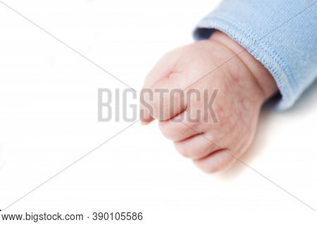 Close Up Of A Child\\\'s Fist On White Background. Clenched Fist - Hand Of Child, Baby Power. New Bo