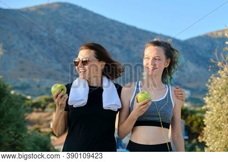 Active Athletic Healthy Family Lifestyle, Smiling Happy Mother And Teenage Daughter Eating Apples, R