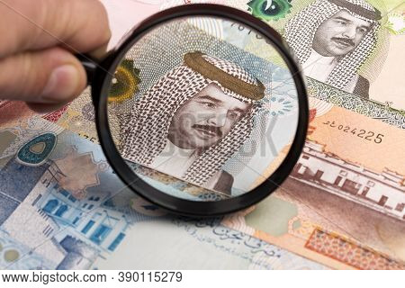Bahraini Dinar In A Magnifying Glass A Business Background