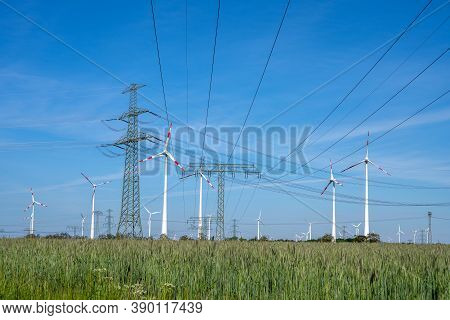 Power Lines, Electricity Pylons And Wind Turbines Seen In Germany
