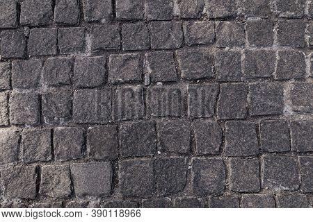 Pavement Texture. Old Paving Stone Mosaic Pattern. Gray Cobblestone Sidewalk Background. Rough Grani