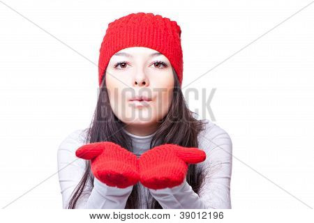 woman in red cap blows