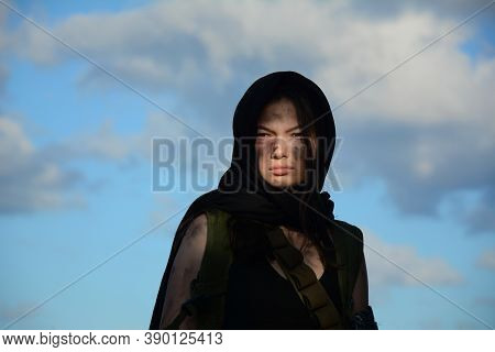 A Female Militia Soldier In A Post Apocalyptic Desert Wasteland. Urban Combat And Wasteland