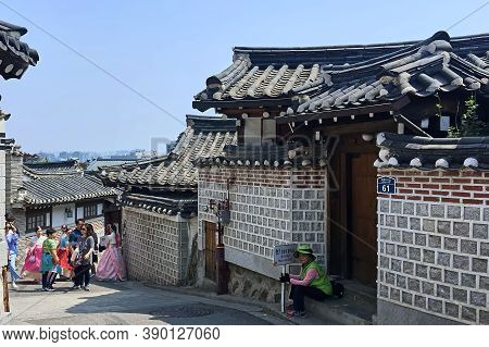 Seoul, South Korea - April 30, 2017: Bukchon Hanok Village - Korean Traditional Village. Tourists Wa
