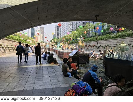 Seoul, South Korea - April 30, 2017: Sunset View Of Cheonggyecheon Stream With Light Decorations And