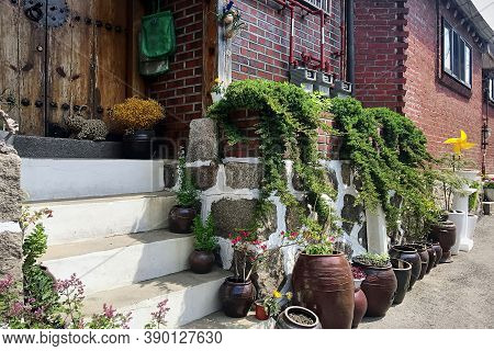 Potted Plants Are At The Entrance To The House. Bukchon Hanok Village - Korean Traditional Village I
