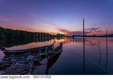 Longtail Boats With Coastal Fishing Village ,beautiful Scenery Morning Sunrise Over Sea And Mountain