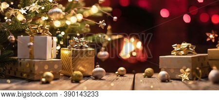 Christmas Tree with Gifts Near a Fireplace with Lights
